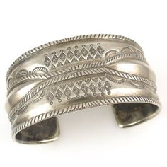 Wide Coin Silver Silver Cuff Bracelet with Stamped and Repousse Designs. Jock Favour uses traditional Navajo silversmithing techniques to create all of his pieces. He forges old silver coins, like mer