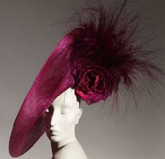 This wine-colored Phillip Treacy is dramatic, but beautiful.