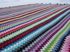 That's one big blanket Diy Crochet, Crochet Hooks, Crochet Ideas, Granny Stripes, Textiles, Yarn Bombing, Crochet Instructions, Afghan Blanket, Crochet Squares