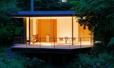 The designers were able to preserve the original floor slab and terrace space that cantilevers over the river.