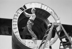 A carpenter of a Detachment of the Heavy Glider Servicing Unit repairing the centre fuselage bulkhead of a damaged Airspeed Horsa in a field near St Aubin-d'Arquenay, Normandy.