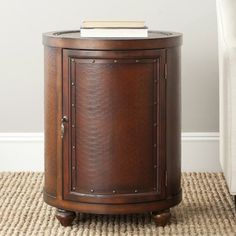 @Overstock.com - Safavieh Felix Dark Brown Side Table - The Felix side table is to the manor born. Crafted with the spirit and decadence of stately homes from decades past, its solid birch wood drum shape construction casts a warm vintage glow in any room.  http://www.overstock.com/Home-Garden/Safavieh-Felix-Dark-Brown-Side-Table/7827711/product.html?CID=214117 $176.85