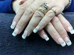 Mandy's nails. Gem sticker accent gel nail art.