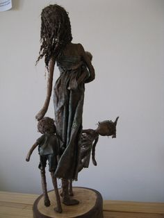 I loved making this fun sculpture depicting a mother with her 3 little children. She carries a baby on her hip who is fascinated by its siblings playfulness and is obviously keen to join in. The boy and girl are playing peekaboo around the mother. In bronze colour with emerald green highlights. The mother stands at 46cm tall including the base and is 37cm at its widest point. Within my sculptures I endeavour to capture an emotional response through movement and dynamics. These are bespoke…