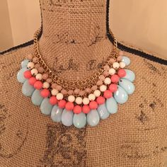 """""""Is That Your Final Statement"""" Necklace NWT  Wearing this light turquoise, coral, cream and light pink on a gold setting necklace you will most certainly get asked, """"where did you get that necklace."""" Jewelry Necklaces"""