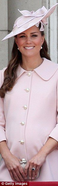 Another pale pink! The duchess is seen on the balcony of Buckingham Palace in 2013 while p... http://dailym.ai/1idWHAt#i-a73a0e5d