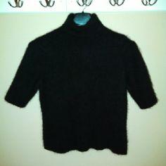 Vintage 1990s Worthington Black Angora Sweater 1990s Black angora short sleeve turtleneck sweater in excellent condition. 55% Angora (Rabbit Hair) 45% Nylon. Hand wash & dry flat. Vintage Sweaters Cowl & Turtlenecks