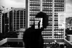 Christopher Anderson  b. Canada, 1970  VENEZUELA. Caracas. 2006. Reflection in window in Altamira.