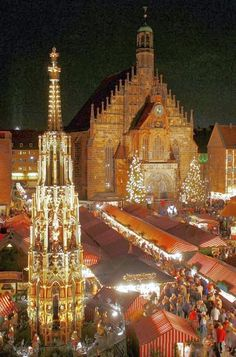 The Christmas market of Nuremberg (Nürnberg), Germany is a colorful traditional attraction. Christmas In Germany, German Christmas Markets, Christmas Markets Europe, Nuremberg Christmas Market, Prague Christmas, Christmas 2014, Oh The Places You'll Go, Places To Travel, Places To Visit