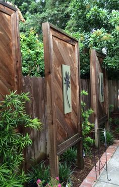 Wood pallet, neighbor privacy panels. I saw these at a garden show. It is perfect idea when neighbor backyard patio is too close for comfort. The placement is slightly staggered.