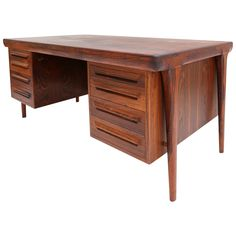 Ib Kofod Larsen Rosewood Desk | See more antique and modern Desks at https://www.1stdibs.com/furniture/storage-case-pieces/desks