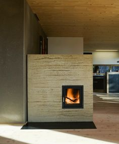 Rammed earth fire place. Awesome thermal mass, used very little wood, and looks fantastic!