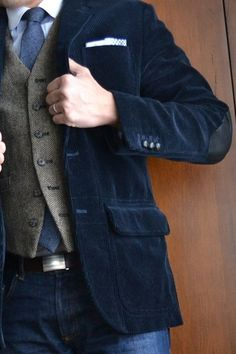 Mens corduroy blazers and pants - Blue corduroy jacket with elbow patches, tweed vest, chambray tie, denim. - Corduroy is the latest trend from comfortable pants to stylish blazers Blue Blazer Outfit Men, Blazer Outfits Men, Tweed Vest, Corduroy Jacket, Workwear Fashion, Mens Fashion Suits, Mens Style Guide, Men Style Tips, Casual Work Wear