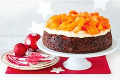 For a fun, family-friendly Christmas dessert try this delicious reindeer carrot cake topped with smooth cream cheese icing and candied carrots.