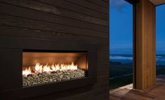 Cosy outdoor living with unbeatable beach views Stone Tile Fireplace, Outdoor Wood Fireplace, Fireplace Tile Surround, Linear Fireplace, Fireplace Cover, Fireplace Surrounds, Outdoor Fireplaces, Outdoor Range, Wood Supply