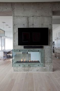 this would be gorgeous in a modern home. Glass Fireplace in a Concrete Wall - Burnaby Residence by Tanya Schoenroth Design Interior Design Minimalist, Home Interior Design, Interior Architecture, Interior And Exterior, Room Interior, Interior Decorating, Decorating Ideas, Industrial House, Modern Industrial