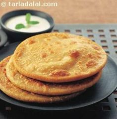 Chana Dal Paratha, whole wheat dough rolled and stuffed with spicy chana dal and onion mixture.