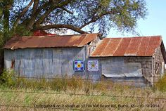 Quilt blocks on metal sheds located at 12794 NW Boyer Rd, Burns, KS