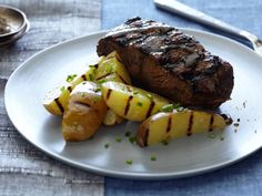 Whiskey Glazed Flat Iron Steaks and Grilled Potatoes recipe from Food Network Kitchen via Food Network