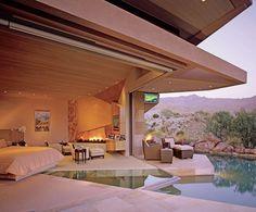 camera da letto con piscina a vista - Design Moderno