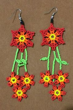 Flower with stem, long earrings Handicrafts Huichol, made by Mexican craftsman's hand Unique piece! Seed Bead Earrings, Flower Earrings, Beaded Earrings, Seed Beads, Crochet Earrings, Long Flowers, Kandi, Beaded Flowers, Bead Weaving