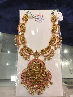 Stunning gold necklace with lord Nataraj pendant. Necklace studded with rubies and emeralds. Necklace with pearl and gold ball hangings. 26 May 2019 Bridal Jewelry Vintage, Bridal Jewellery, Wedding Jewelry, Gold Jewellery, Latest Jewellery, Jewlery, Jewelry Necklaces, Antique Jewellery Designs, Jewelry Design