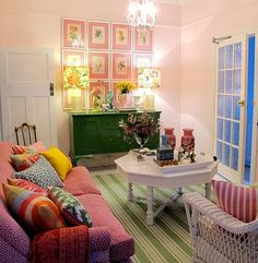Not sure, but I love the gingham mats on the pictures and the painted coffee table!