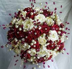 Red and White Rose Wedding Bouquet, love the pearls....I want these delivered!