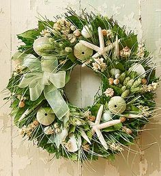 Welcome summer with this unique beach themed wreath featuring philaris, larkspur, star fish, sea shells and more! Perfect for a table centerpiece or to adorn your door!