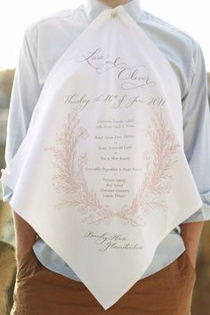 menu screen-printed on napkins (with button holes!) by a friend of the couple