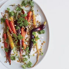 Roasted Carrots with Caraway and Coriander | This lovely dish combines a trio of ingredients from the same family: sweet roasted carrots, coriander and caraway.