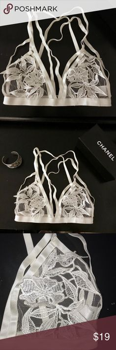 {e.ssue} white floral appliqué bralette White lace/sheer detailed bralette. Floral details. Double straps. Some small loose threads (see photos). Size S. Perfect under tank or dress. Elegant and sexy. Note: some loose strings. One strap looks loose but it really just needs to be tucked in (see photos). Essue Intimates & Sleepwear Bandeaus