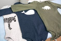 DIY animal onsies :) freezer paper stencil or heat transfer vinyl.  Just look at the technique, I'm envisioning doing OTY images on tanks for tees.