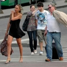 Busted In This Picture: Photo of guy checking out girl