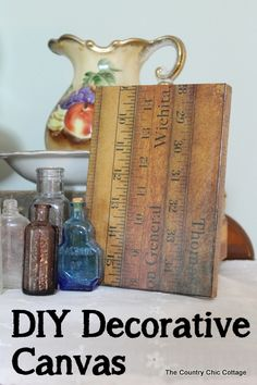 DIY Decorative Canvas -- turn any canvas art you can find at the thrift store into a customized piece of art for your home in under 10 minut...