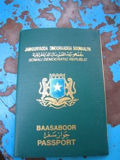 The old Somali green passport. It's time has passed. The new Somali passport is a different color now and it has a chip.     I still have my passport although it is long expired...a good reason to hold on to it since they no longer produce them.
