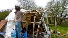 Improvised shelters made of branches or saplings and covered with tarps provide emergency shelter as well as a place to live while your home. Bushcraft Skills, Bushcraft Camping, Diy Camping, Survival Shelter, Survival Prepping, Survival Skills, Survival Tent, Survival Fishing, Bushcraft Backpack