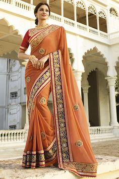ORANGE GEORGETTE WITH HEAVY WORK FANCY DESIGNER WEDDING SAREE at Lalgulal.com. To Order :- http://goo.gl/sAEwRB. To Order you Call or Whatsapp us on +91-95121-50402. COD & Free Shipping Available only in India.