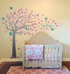 My purple & teal nursery is 1/2 way complete. I love my custom tree by Surface Inspired. *Crib- Bassett  *Rug- Target *Bedding- Pottery Barn