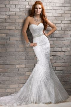 Beautiful lace gown. I would dye it a blush color or pale purple