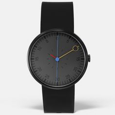 This unique watch features a brushed-black stainless-steel case, with dark grey face. Black indices and red, blue and gold hands indicate the time. #watches #Romanian #design