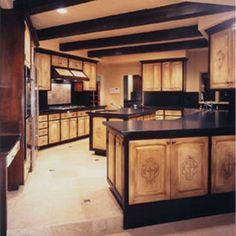 Until we can redo the kitchen completely, I might do up my kitchen cupboards something like this.  Not the dark counter-tops or the rafters on the ceiling.  Just update the cabinets from the 1980's orange, high gloss color they are now.  ~CatSnap~