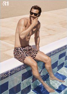 Summer ready, John Halls wears a pair of parrot print swim trunks from Scotch & Soda.