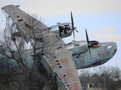 A deeply damaged abandoned plane monument in Ukraine.