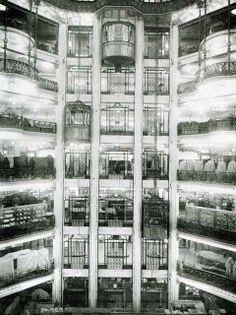 """Printemps Haussmann Paris - the panoramic elevators of the """"Nouveaux Magasins"""" (the actual Printemps Mode) in 1924."""