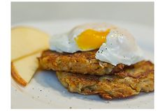 2 russet or Yukon Gold potatoes 1 crisp apple 1 small onion, peeled Salt and pepper to taste 1 large egg, beaten Vegetable oil for frying 1 egg, poached (optional)