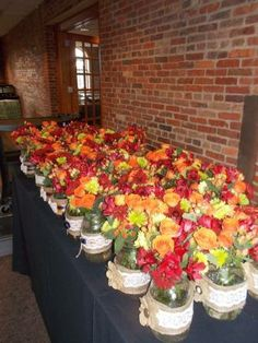 Camden Yards Reception Hall, Baltimore, Maryland. November 23, 2013 Wedding. Flowers: Alstromeria, peach sweetheart roses, hypericum (berries on a stick), green button mums, maroon mums. Vintage theme with lots of burlap and rustic accents.