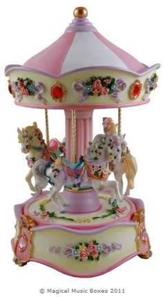 'Céleste' ~ Miniature musical carousel with 3 individual decorative horses. Hand painted, the horses are each mounted on brass rods & as the top rotates the music box plays /  Carousels of Distinction