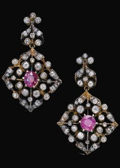 A pair of antique diamond and ruby earrings, 19th century. Set with circular-cut…