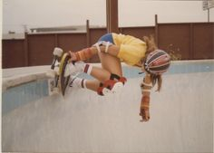 Cindy Whitehead board grab in the pool. 1970s.